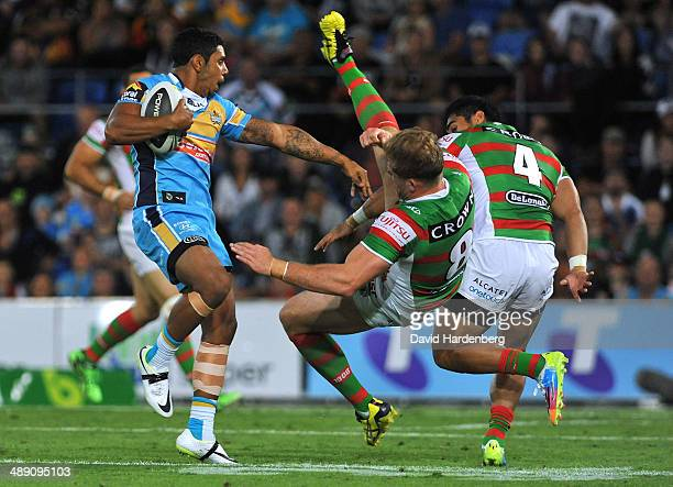Albert Kelly of the Titans pushes George Burgess of the Rabbitohs during the round nine NRL match between the Gold Coast Titans and the South Sydney...