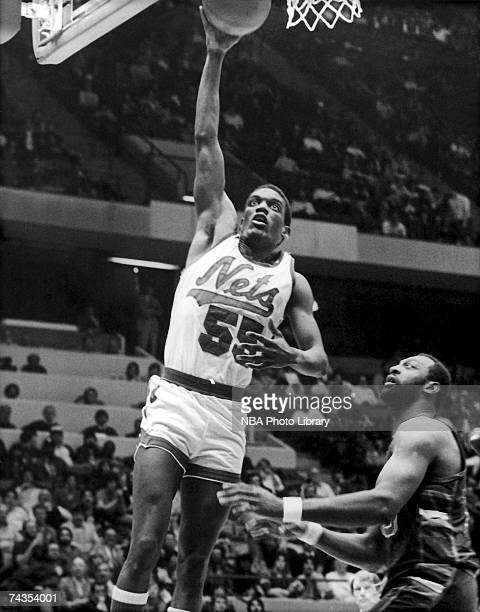 Albert King of the New Jersey Nets attempts a dunk against the Sacramento Kings during a 1985 NBA game at Brendan Byrne Arena in East Rutherford New...