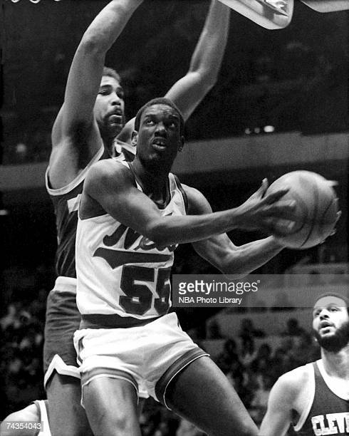 Albert King of the New Jersey Nets attempts a layup against the Cleveland Cavaliers during a 1985 NBA game at Brendan Byrne Arena in East Rutherford...