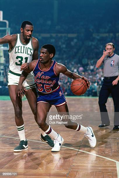 Albert King of the New Jersey Nets moves the ball against Cedric Maxwell of the Boston Celtics during a game played in 1983 at the Boston Garden in...
