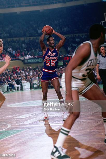 Albert King of the New Jersey Nets passes against the Boston Celtics during a game played in 1982 at the Boston Garden in Boston Massachusetts NOTE...