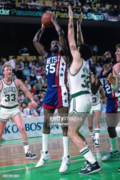 Albert King of the New Jersey Nets shoots against Kevin McHale of the Boston Celtics during a game circa 1986 at the Boston Garden in Boston...