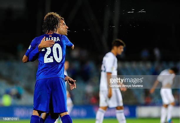 Albert Lopo Garcia of Getafe spits while Juna Valera Espin embraces him at the end of the la Liga match between Getafe and Real Madrid at Coliseum...