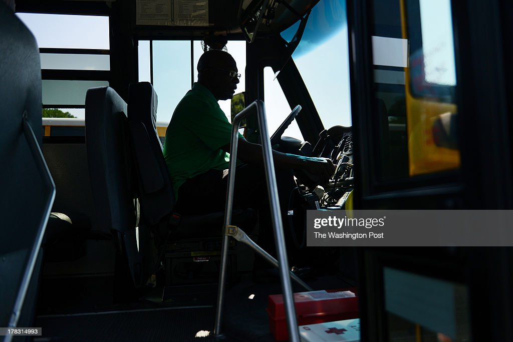 Albert Luster, a bus driver trainee, takes the driver's seat during a training in one of Prince William County's many school buses at the Prince William County Public Schools' central school bus station on Thursday, August, 22, in Manassas, VA. Bus drivers, mechanics, and all the support staff of the county's school vehicle services is gearing up for the September 3 start date of the 2013-2014 school year.