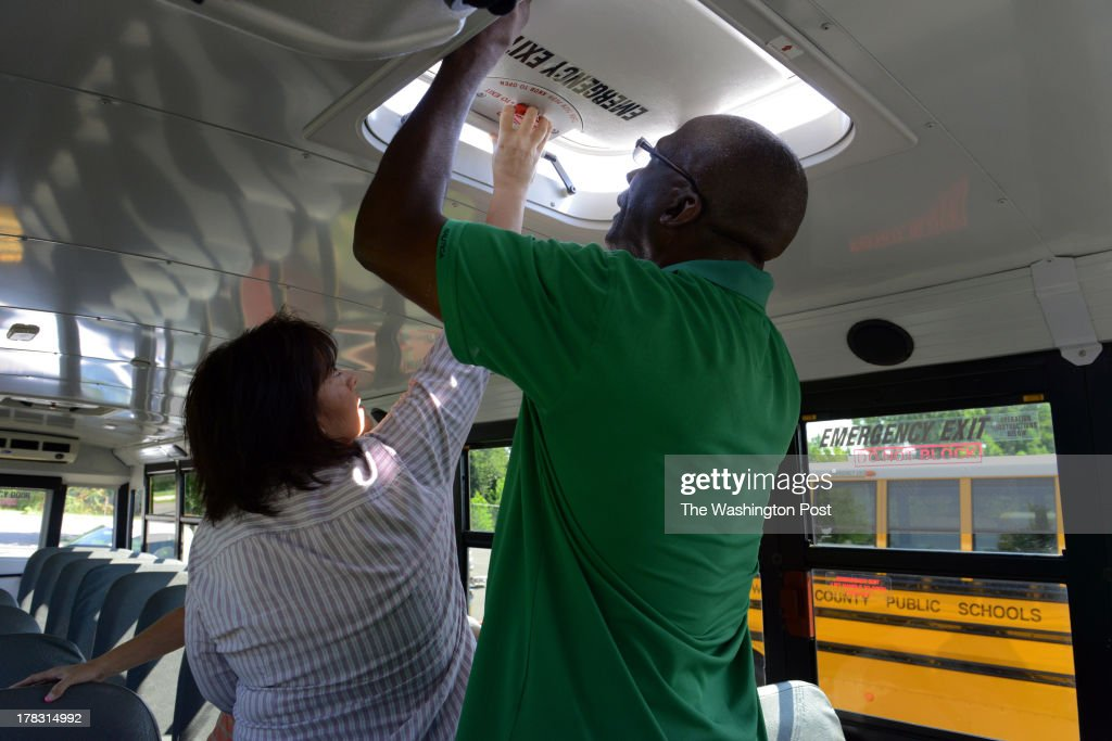 Albert Luster, R, a bus driver trainee, trains with safety and training instructor Debby Lear in one of Prince William County's many school buses at the Prince William County Public Schools' central school bus station on Thursday, August, 22, in Manassas, VA. Bus drivers, mechanics, and all the support staff of the county's school vehicle services is gearing up for the September 3 start date of the 2013-2014 school year.