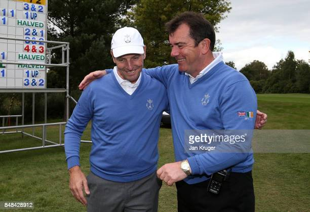 Albert MacKenzie Captain of the Great Britain and Ireland PGA Cup team celebrate with David Higgins after the the singles matches on the final day of...