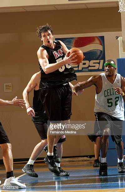 Albert Miralles of the Miami Heat rebounds against the Boston Celtics during a NBA Pepsi Pro Summer League game July 8 2004 at the RDV Sportsplex in...