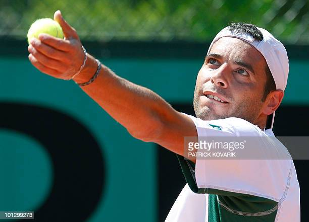 Albert Montanes of Spain serves to Stefano Galvani of Italy during their men's first round match at the French Open tennis championship at the Roland...
