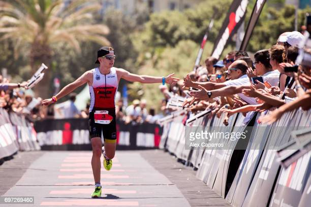 Albert Moreno of Spain celebrates as he finishes in 3rd place Ironman 703 Italy race on June 18 2017 in Pescara Italy