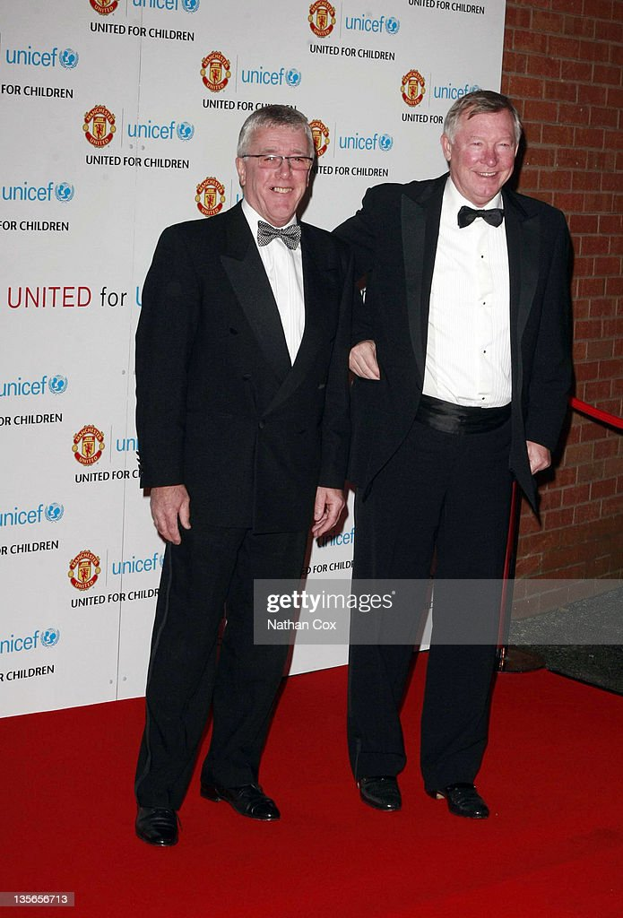 Albert Morgan and Sir Alex Ferguson attend Manchester United 'United for UNICEF' Gala Dinner at Old Trafford on December 12 2011 in Manchester England