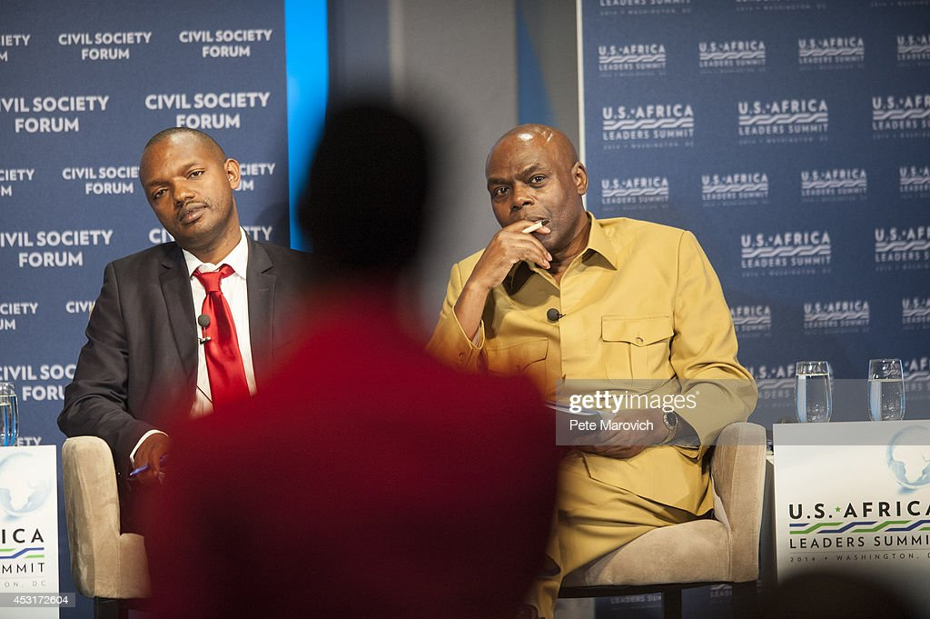 Albert Nzamukwereka of Rwanda (L) and Shaka Ssali of Uganda look on as an audience member asks a question to the panel at the Civil Society Forum at the National Academy of Sciences as part of the first U.S.-Africa Leaders Summit on August 4, 2014 in Washington, DC. The event is set to promote business relationships between the United States and African countries during the first-ever leaders summit, where 49 heads of state will be meeting in Washington over the next three days.
