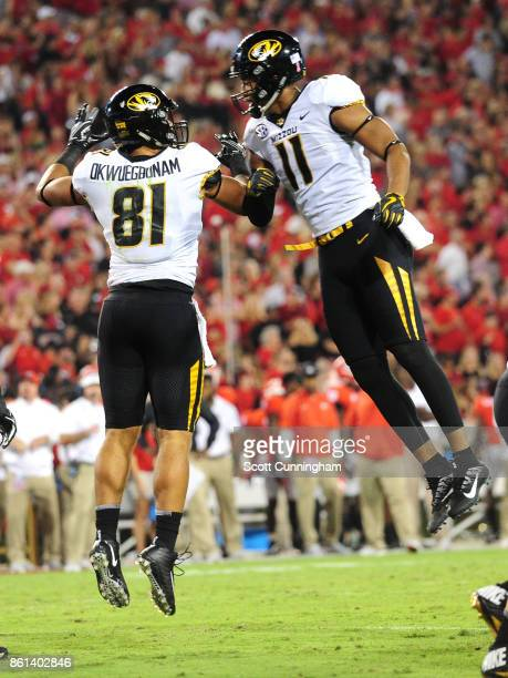 Albert Okwuegbunam of the Missouri Tigers is congratulated by Kendall Blanton after scoring a 1st quarter touchdown against the Georgia Bulldogs at...