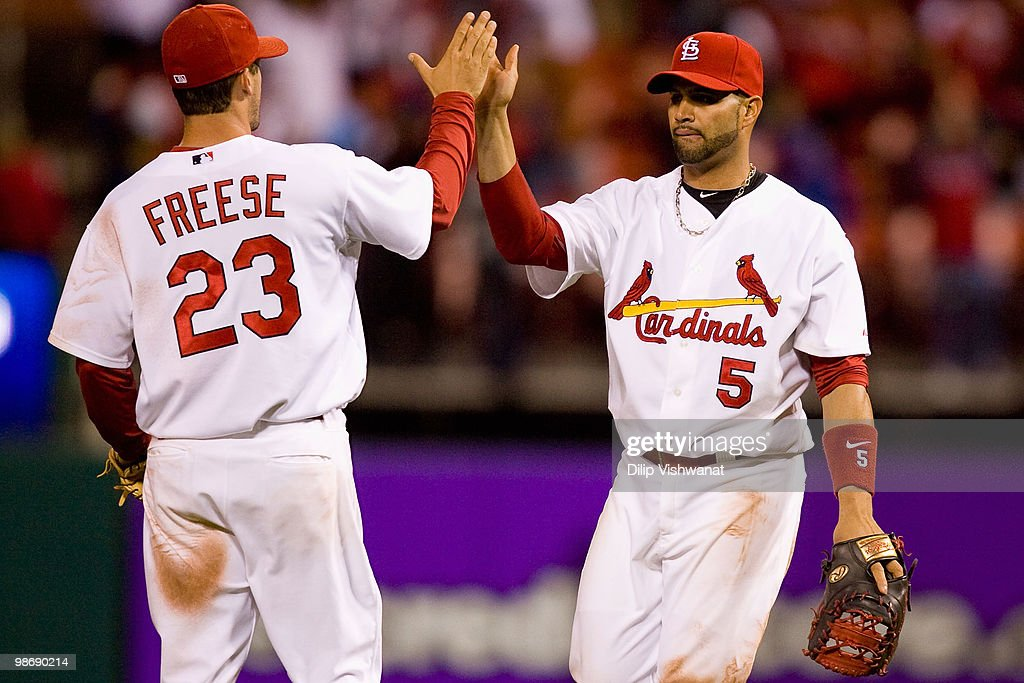 Albert Pujols #5 and David Freese #23 both of the St. Louis Cardinals celebrate beating the Atlanta Braves at Busch Stadium on April 26, 2010 in St. Louis, Missouri. The Cardinals beat the Braves 4-3.