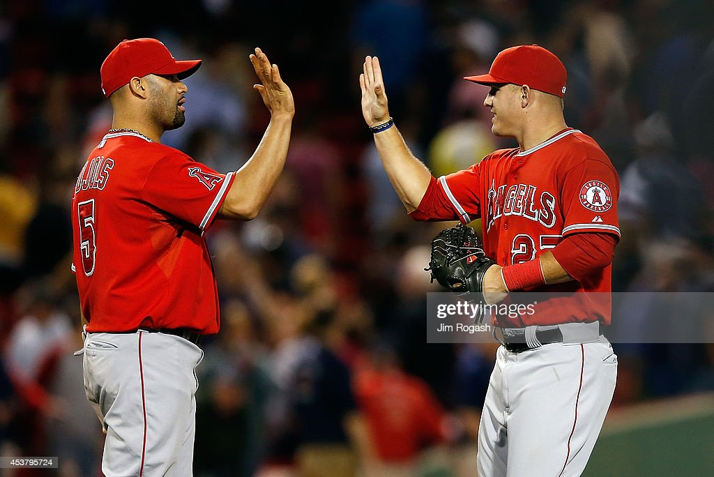 <a gi-track='captionPersonalityLinkClicked' href=/galleries/search?phrase=Albert+Pujols&family=editorial&specificpeople=171151 ng-click='$event.stopPropagation()'>Albert Pujols</a> #5 and <a gi-track='captionPersonalityLinkClicked' href=/galleries/search?phrase=Mike+Trout&family=editorial&specificpeople=7091306 ng-click='$event.stopPropagation()'>Mike Trout</a> #27 of the Los Angeles Angels celebrate a 4-2 win over the Boston Red Sox at Fenway Park on August 18, 2014 in Boston, Massachusetts.