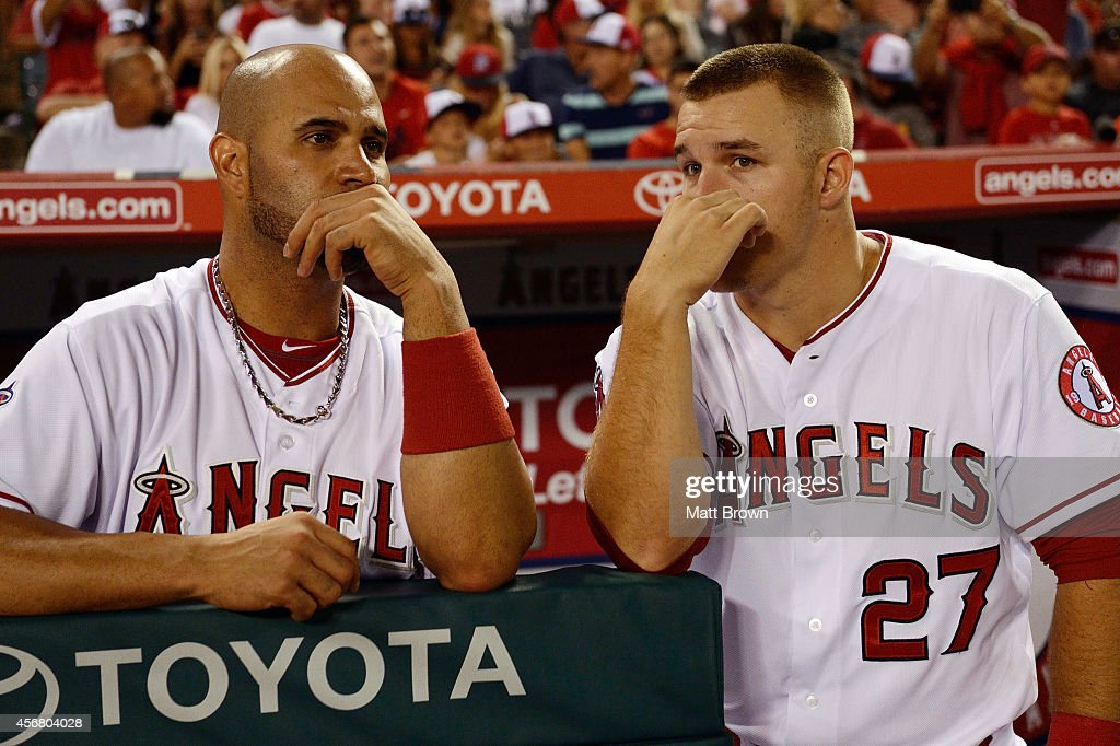 Albert Pujols #5 and Mike Trout #27 of the Los Angeles Angels of Anaheim during the game against the Houston Astros on July 5, 2014 at Angel Stadium of Anaheim in Anaheim, California.