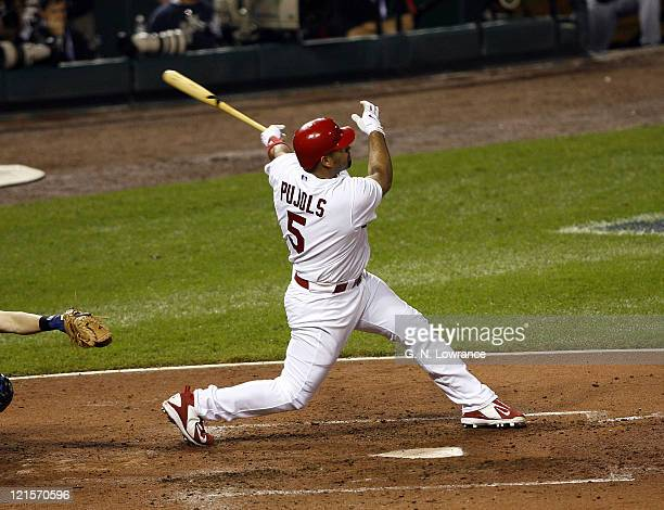 Albert Pujols hits a solo home run in the 4th inning during game 5 action of the NLCS between the New York Mets and St Louis Cardinals at Busch...