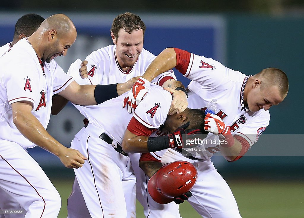<a gi-track='captionPersonalityLinkClicked' href=/galleries/search?phrase=Albert+Pujols&family=editorial&specificpeople=171151 ng-click='$event.stopPropagation()'>Albert Pujols</a> #5, Josh Hamilton #32, <a gi-track='captionPersonalityLinkClicked' href=/galleries/search?phrase=Erick+Aybar&family=editorial&specificpeople=551376 ng-click='$event.stopPropagation()'>Erick Aybar</a> #2 and <a gi-track='captionPersonalityLinkClicked' href=/galleries/search?phrase=Mike+Trout&family=editorial&specificpeople=7091306 ng-click='$event.stopPropagation()'>Mike Trout</a> #27 of the Los Angeles Angels of Anaheim celebrate Aybar's walk off single against the St. Louis Cardinals in the ninth inning at Angel Stadium of Anaheim on July 4, 2013 in Anaheim, California. The Angels defeated the Cardinals 6-5.