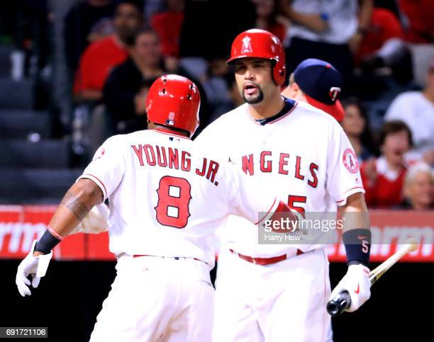 Albert Pujols of the Los Angeles Angels celebrate the run of Eric Young Jr #8 to trail 71 to the Minnesota Twins during the sixth inning at Angel...