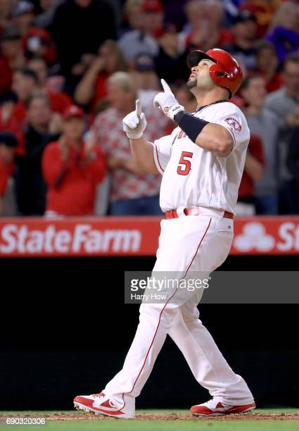 Albert Pujols of the Los Angeles Angels celebrates his 599th homerun for his career with two men on base to take a 32 lead over the Atlanta Braves...
