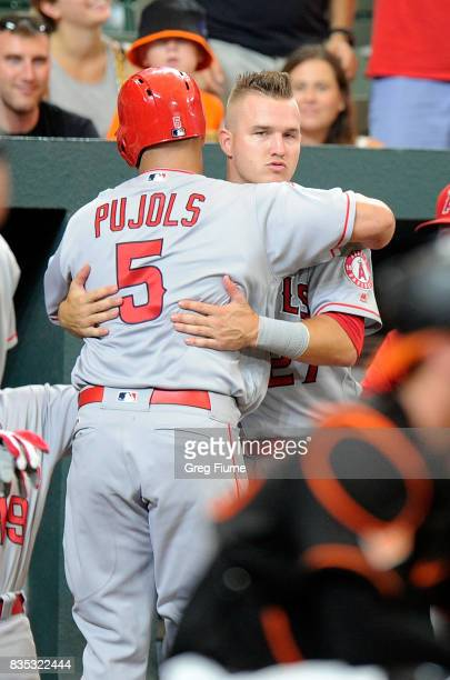 Albert Pujols of the Los Angeles Angels celebrates with Mike Trout after hitting a tworun home run in the first inning against the Baltimore Orioles...
