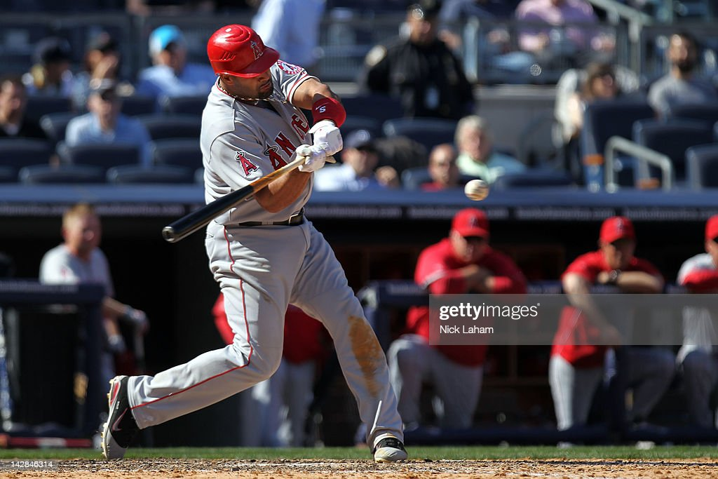<a gi-track='captionPersonalityLinkClicked' href=/galleries/search?phrase=Albert+Pujols&family=editorial&specificpeople=171151 ng-click='$event.stopPropagation()'>Albert Pujols</a> #5 of the Los Angeles Angels grounds into a double play in the ninth inning against the New York Yankees during the home opener at Yankee Stadium on April 13, 2012 in the Bronx borough of New York City.