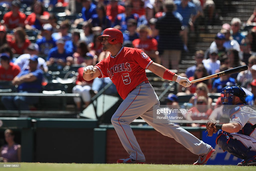 Albert Pujols #5 of the Los Angeles Angels hits a single against the Texas Rangers in the fourth inning at Globe Life Park in Arlington on May 1, 2016 in Arlington, Texas.