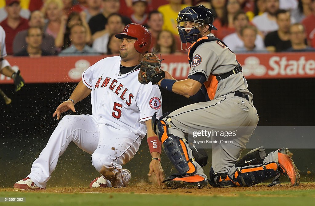 <a gi-track='captionPersonalityLinkClicked' href=/galleries/search?phrase=Albert+Pujols&family=editorial&specificpeople=171151 ng-click='$event.stopPropagation()'>Albert Pujols</a> #5 of the Los Angeles Angels is tagged out at home by <a gi-track='captionPersonalityLinkClicked' href=/galleries/search?phrase=Jason+Castro+-+Baseball+Player&family=editorial&specificpeople=7443916 ng-click='$event.stopPropagation()'>Jason Castro</a> #15 of the Houston Astros in the seventh inning of the game at Angel Stadium of Anaheim on June 27, 2016 in Anaheim, California.