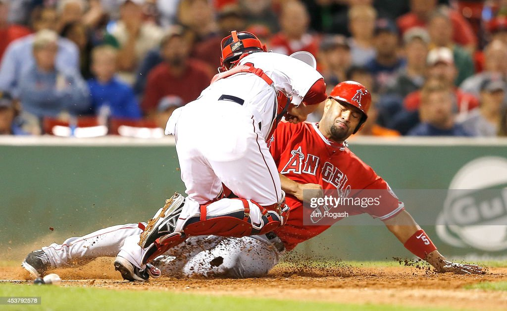 <a gi-track='captionPersonalityLinkClicked' href=/galleries/search?phrase=Albert+Pujols&family=editorial&specificpeople=171151 ng-click='$event.stopPropagation()'>Albert Pujols</a> #5 of the Los Angeles Angels is tagged out at the plate by Christian Vazquez #55 of the Boston Red Sox in the eighth inning at Fenway Park on August 18, 2014 in Boston, Massachusetts.