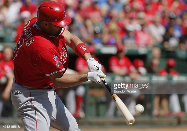 Albert Pujols of the Los Angeles Angels makes contact for a tworun home run during the first inning of a baseball game against the Texas Rangers at...