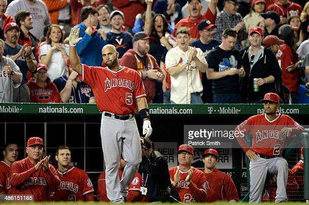 Albert Pujols of the Los Angeles Angels of Anaheim acknowledges the crowd after hitting a tworun home run against the Washington Nationals in the...