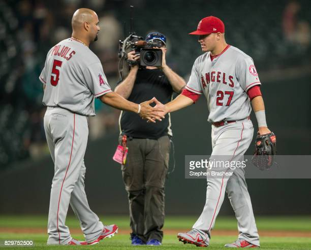 Albert Pujols of the Los Angeles Angels of Anaheim and Mike Trout of the Los Angeles Angels of Anaheim celebrate a victory after a game against the...