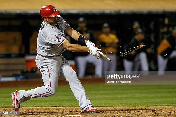 Albert Pujols of the Los Angeles Angels of Anaheim breaks his bat on a ground out during the ninth inning against the Oakland Athletics at the...
