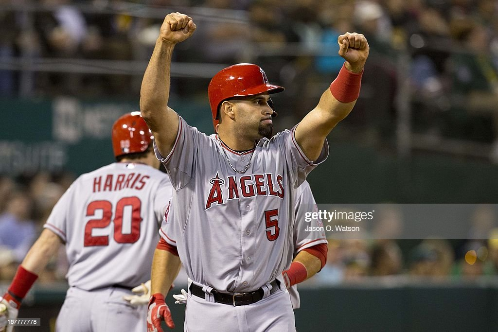 Albert Pujols #5 of the Los Angeles Angels of Anaheim celebrates after scoring on a two RBI double from Mark Trumbo #44 of the Los Angeles Angels of Anaheim (not pictured) during the fifth inning against the Oakland Athletics at O.co Coliseum on April 29, 2013 in Oakland, California.