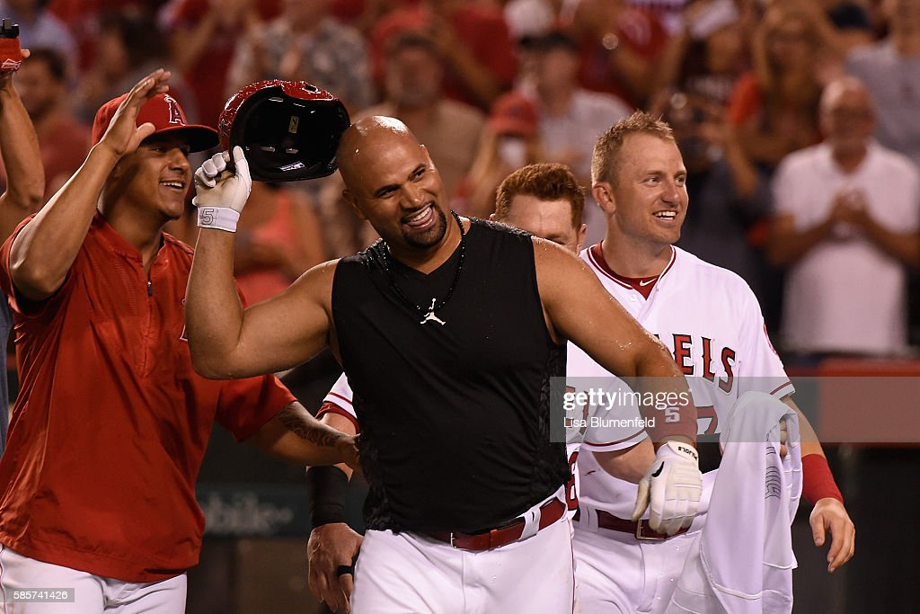 Albert Pujols #5 of the Los Angeles Angels of Anaheim celebrates after hitting a walk off two run homerun to defeat the Oakland Athletics 8-6 at Angel Stadium of Anaheim on August 3, 2016 in Anaheim, California.