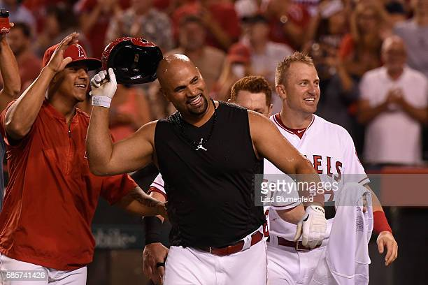Albert Pujols of the Los Angeles Angels of Anaheim celebrates after hitting a walk off two run homerun to defeat the Oakland Athletics 86 at Angel...