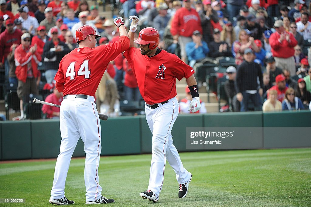 <a gi-track='captionPersonalityLinkClicked' href=/galleries/search?phrase=Albert+Pujols&family=editorial&specificpeople=171151 ng-click='$event.stopPropagation()'>Albert Pujols</a> #5 of the Los Angeles Angels of Anaheim celebrates with teammate <a gi-track='captionPersonalityLinkClicked' href=/galleries/search?phrase=Mark+Trumbo&family=editorial&specificpeople=4921667 ng-click='$event.stopPropagation()'>Mark Trumbo</a> #44 after hitting a home run against the Colorado Rockies at Tempe Diablo Stadium on March 9, 2013 in Peoria, Arizona.