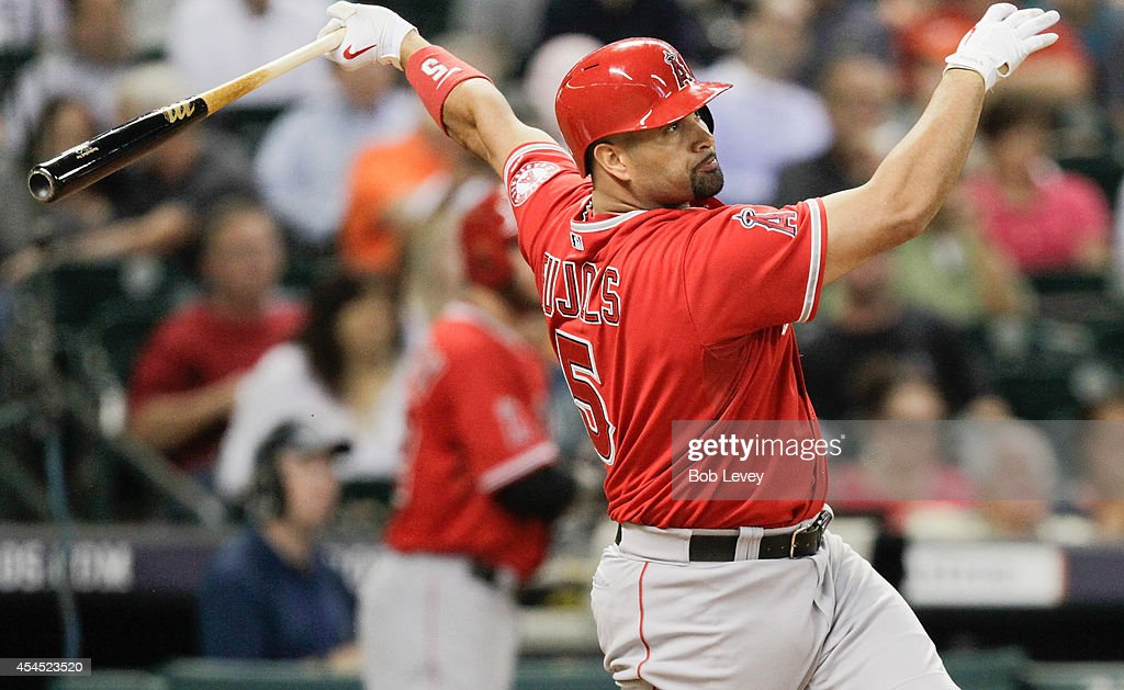 <a gi-track='captionPersonalityLinkClicked' href=/galleries/search?phrase=Albert+Pujols&family=editorial&specificpeople=171151 ng-click='$event.stopPropagation()'>Albert Pujols</a> #5 of the Los Angeles Angels of Anaheim drives the ball to deep center where Dexter Fowler #21 of the Houston Astros dropped the ball int he sixth inning at Minute Maid Park on September 2, 2014 in Houston, Texas.