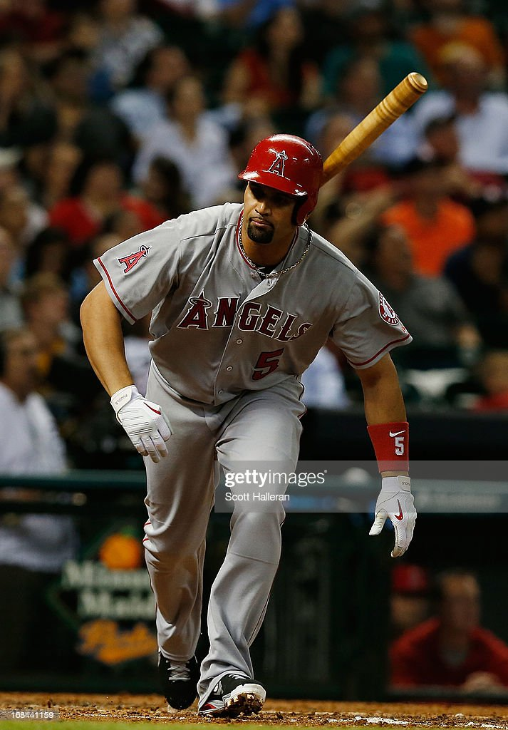 <a gi-track='captionPersonalityLinkClicked' href=/galleries/search?phrase=Albert+Pujols&family=editorial&specificpeople=171151 ng-click='$event.stopPropagation()'>Albert Pujols</a> #5 of the Los Angeles Angels of Anaheim flys out to center field during the third inning of the game against the Houston Astros at Minute Maid Park on May 9, 2013 in Houston, Texas.