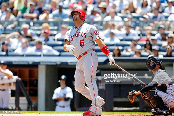 Albert Pujols of the Los Angeles Angels of Anaheim follows through on a first inning home run against the New York Yankees at Yankee Stadium on June...
