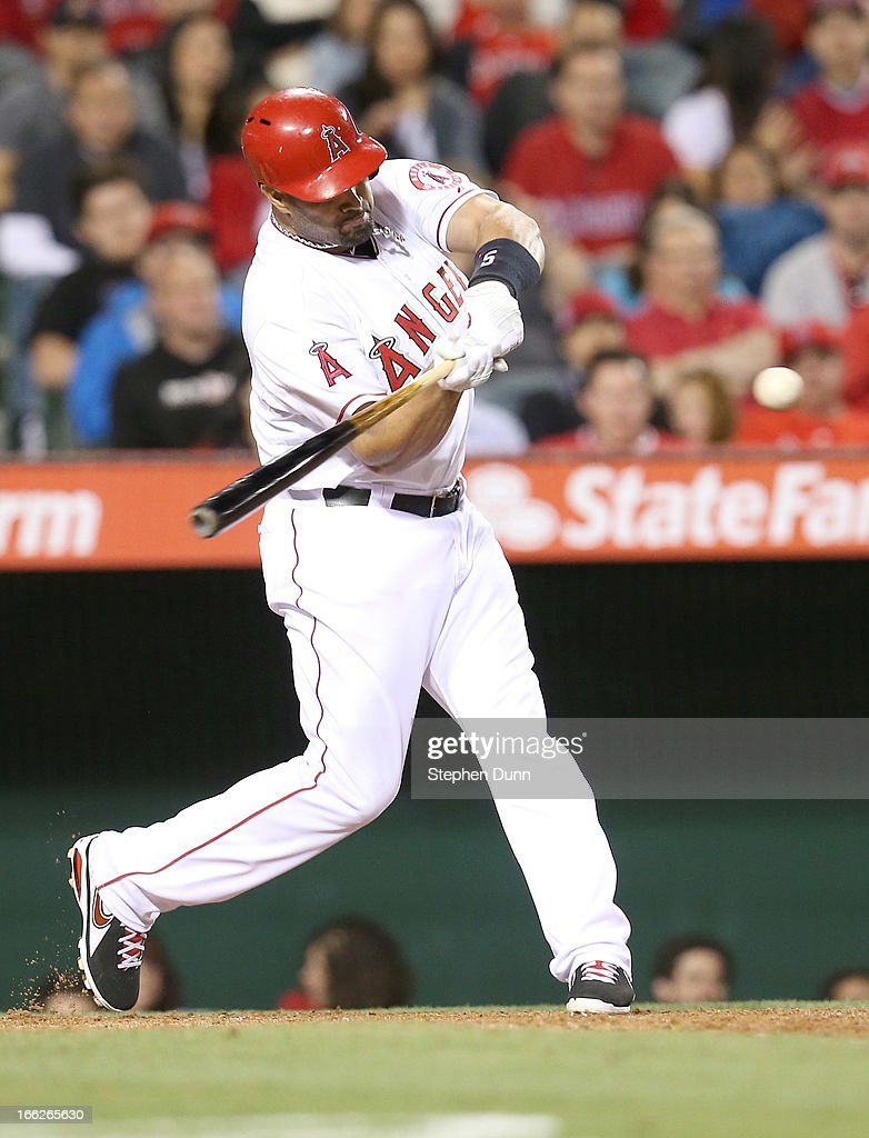 <a gi-track='captionPersonalityLinkClicked' href=/galleries/search?phrase=Albert+Pujols&family=editorial&specificpeople=171151 ng-click='$event.stopPropagation()'>Albert Pujols</a> #5 of the Los Angeles Angels of Anaheim hits a ground rule double in the fifth inning against the Oakland Athletics at Angel Stadium of Anaheim on April 10, 2013 in Anaheim, California.