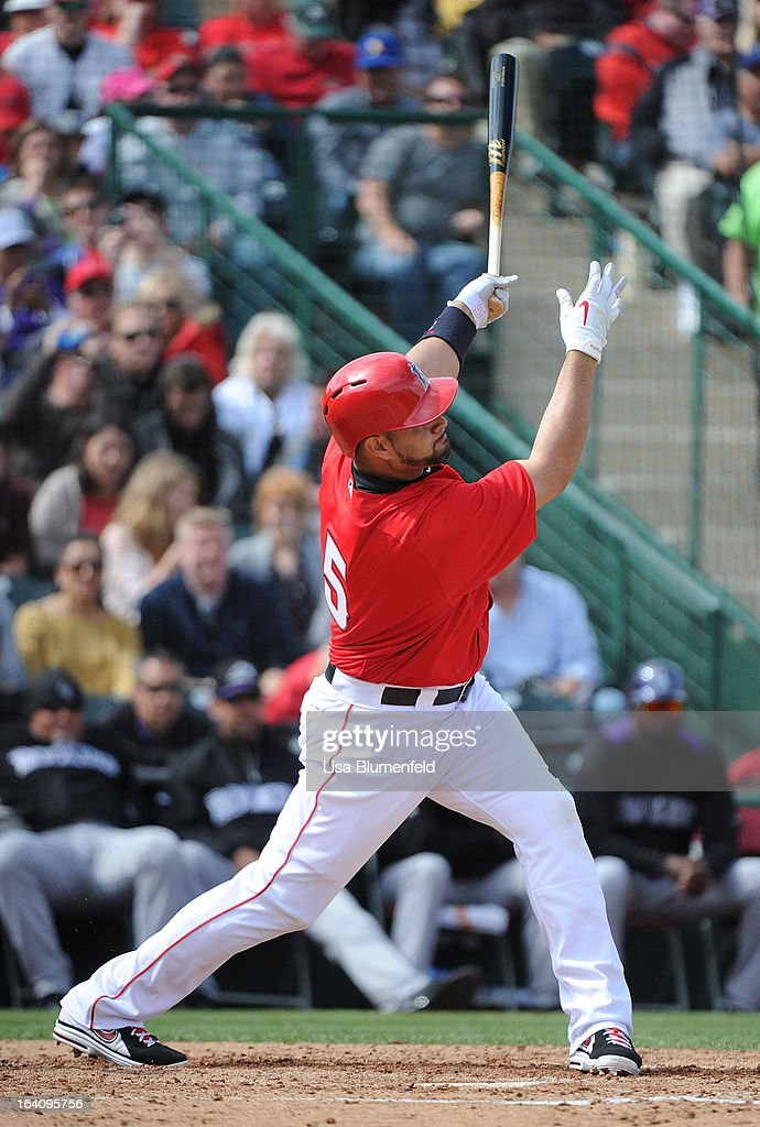 <a gi-track='captionPersonalityLinkClicked' href=/galleries/search?phrase=Albert+Pujols&family=editorial&specificpeople=171151 ng-click='$event.stopPropagation()'>Albert Pujols</a> #5 of the Los Angeles Angels of Anaheim hits a home run against the Colorado Rockies at Tempe Diablo Stadium on March 9, 2013 in Peoria, Arizona.