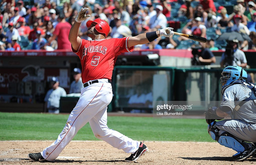<a gi-track='captionPersonalityLinkClicked' href=/galleries/search?phrase=Albert+Pujols&family=editorial&specificpeople=171151 ng-click='$event.stopPropagation()'>Albert Pujols</a> #5 of the Los Angeles Angels of Anaheim hits a homerun in the sixth inning against the Tampa Bay Rays at Angel Stadium of Anaheim on August 19, 2012 in Anaheim, California.