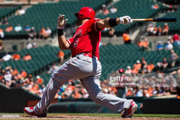 Albert Pujols of the Los Angeles Angels of Anaheim hits a RBI single in the third inning during a game against the Baltimore Orioles at Oriole Park...