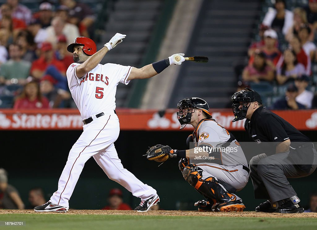 <a gi-track='captionPersonalityLinkClicked' href=/galleries/search?phrase=Albert+Pujols&family=editorial&specificpeople=171151 ng-click='$event.stopPropagation()'>Albert Pujols</a> #5 of the Los Angeles Angels of Anaheim hits a solo home run against the Baltimore Orioles in the ninth inning at Angel Stadium of Anaheim on May 2, 2013 in Anaheim, California. The Orioles defeated the Angels 5-1.