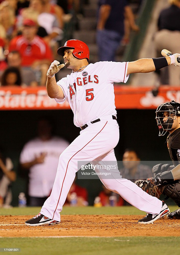 Albert Pujols #5 of the Los Angeles Angels of Anaheim hits a solo home run in the seventh inning during the MLB game against the Pittsburgh Pirates at Angel Stadium of Anaheim on June 21, 2013 in Anaheim, California.