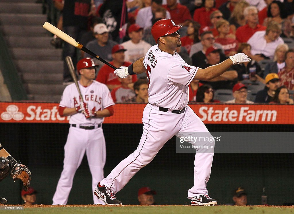<a gi-track='captionPersonalityLinkClicked' href=/galleries/search?phrase=Albert+Pujols&family=editorial&specificpeople=171151 ng-click='$event.stopPropagation()'>Albert Pujols</a> #5 of the Los Angeles Angels of Anaheim hits a solo home run in the seventh inning during the MLB game against the Pittsburgh Pirates at Angel Stadium of Anaheim on June 21, 2013 in Anaheim, California. The Pirates defeated the Angels 5-2.