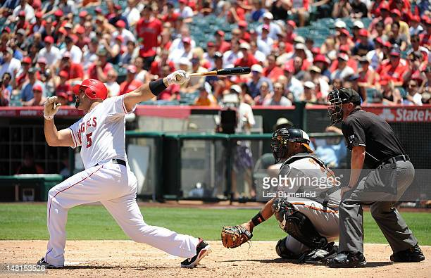 Albert Pujols of the Los Angeles Angels of Anaheim hits a two run homerun in the third inning against the Baltimore Orioles at Angel Stadium of...