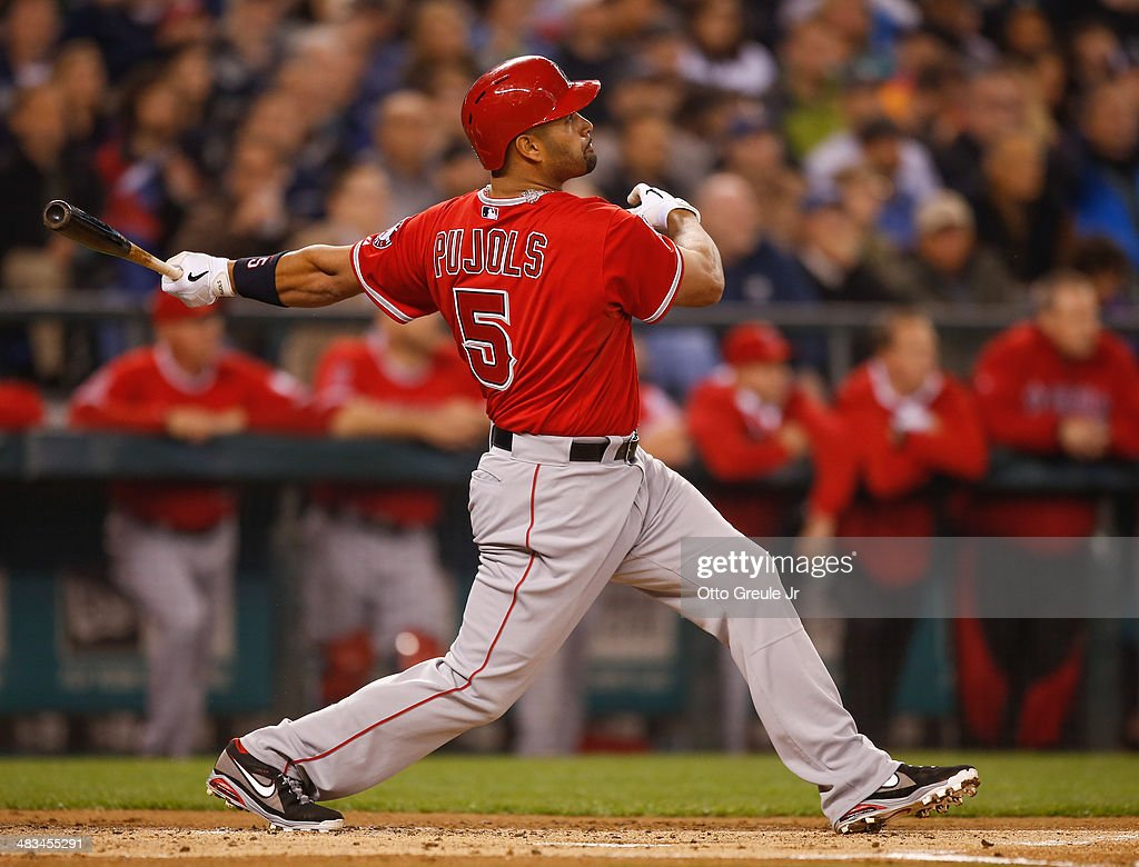 <a gi-track='captionPersonalityLinkClicked' href=/galleries/search?phrase=Albert+Pujols&family=editorial&specificpeople=171151 ng-click='$event.stopPropagation()'>Albert Pujols</a> #5 of the Los Angeles Angels of Anaheim hits a two-run homer in the first inning against the Seattle Mariners on Opening Day at Safeco Field on April 8, 2014 in Seattle, Washington.