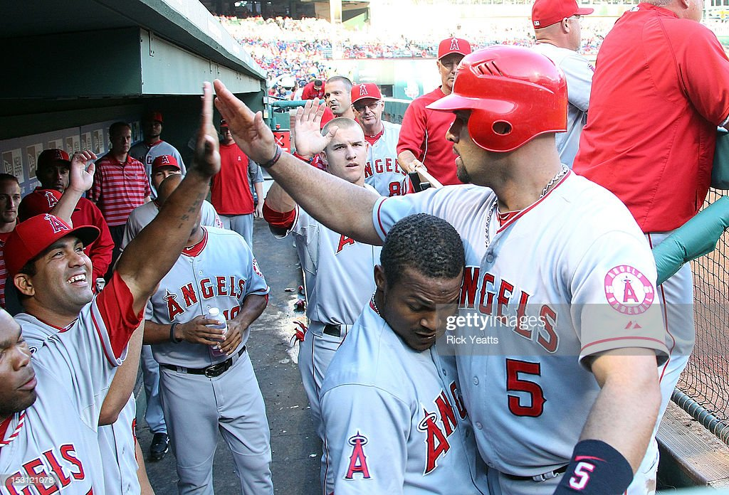 <a gi-track='captionPersonalityLinkClicked' href=/galleries/search?phrase=Albert+Pujols&family=editorial&specificpeople=171151 ng-click='$event.stopPropagation()'>Albert Pujols</a> #5 of the Los Angeles Angels of Anaheim is congratulated by his team mates for scoring in game two of the double header against the Texas Rangers at Rangers Ballpark in Arlington on September 30, 2012 in Arlington, Texas.