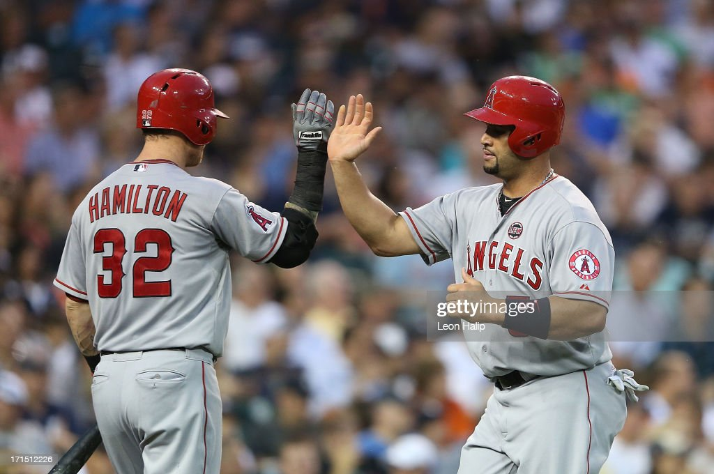 <a gi-track='captionPersonalityLinkClicked' href=/galleries/search?phrase=Albert+Pujols&family=editorial&specificpeople=171151 ng-click='$event.stopPropagation()'>Albert Pujols</a> #5 of the Los Angeles Angels of Anaheim is congratulated by teammate Josh Hamilton #32 after scoring on the single to center field by Howard Kendrick #47 during the fifth inning of the game against the Detroit Tigers at Comerica Park on June 25, 2013 in Detroit, Michigan.